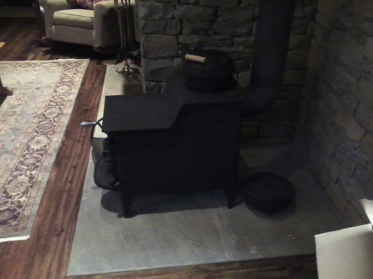 This Baby Bear was what heated the old house that was tore down and  rebuilt. The owners wanted to keep the the original stove ... - Fisher Baby Bear Unique Setup Hearth.com Forums Home