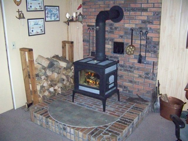 My main floor stove is inside a remodeled fireplace and basement stove is  on a 5' x 5' brick hearth on top of the cement slab. Woodstock has some  good info ... - 1000 Sf In Northern Wisc. (f500 Oslo Question) Hearth.com Forums