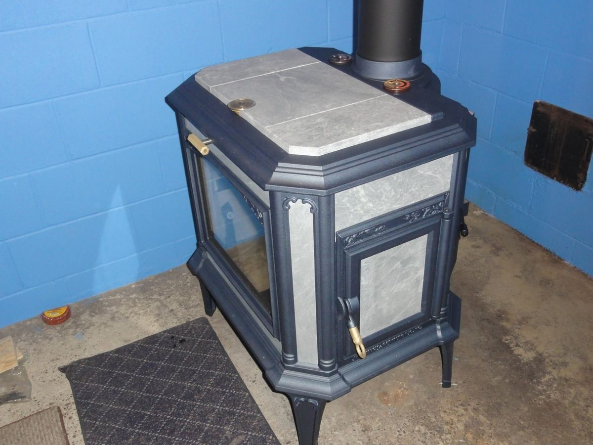 Installed, break in fires, and burning, tile for the floor - another day  700 pounds of work but what a awesome stove, I think its a keeper - New Progress Hybrid Installed (pics) Hearth.com Forums Home