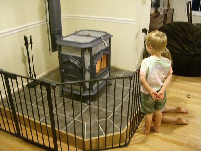 Just wondering if anyone knows of a good safety gate to put around a wood stove. We have a 4 yr and 2yr old and want to keep them away . Links or pics...