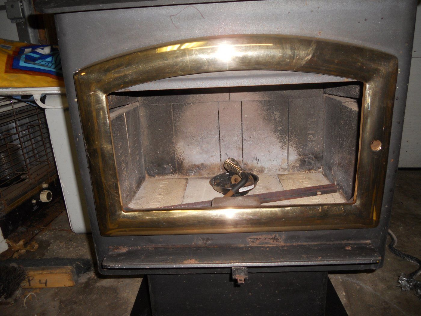 It was made in 96 so says the sticker on the back. Here are some pictures  of the package deal. I did clean up the brass door myself and pulled the  old ... - Arrow Stoves, Any Good? Hearth.com Forums Home