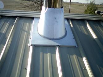 Metal flue roof penetration