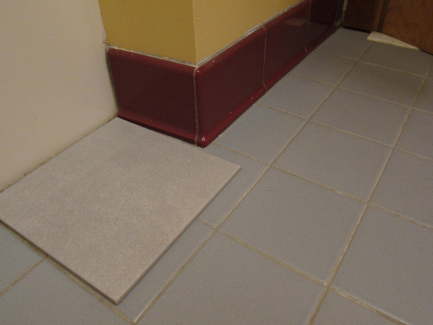 Wooden baseboard in a tile floor bathroom hearth forums home img1078g dailygadgetfo Images