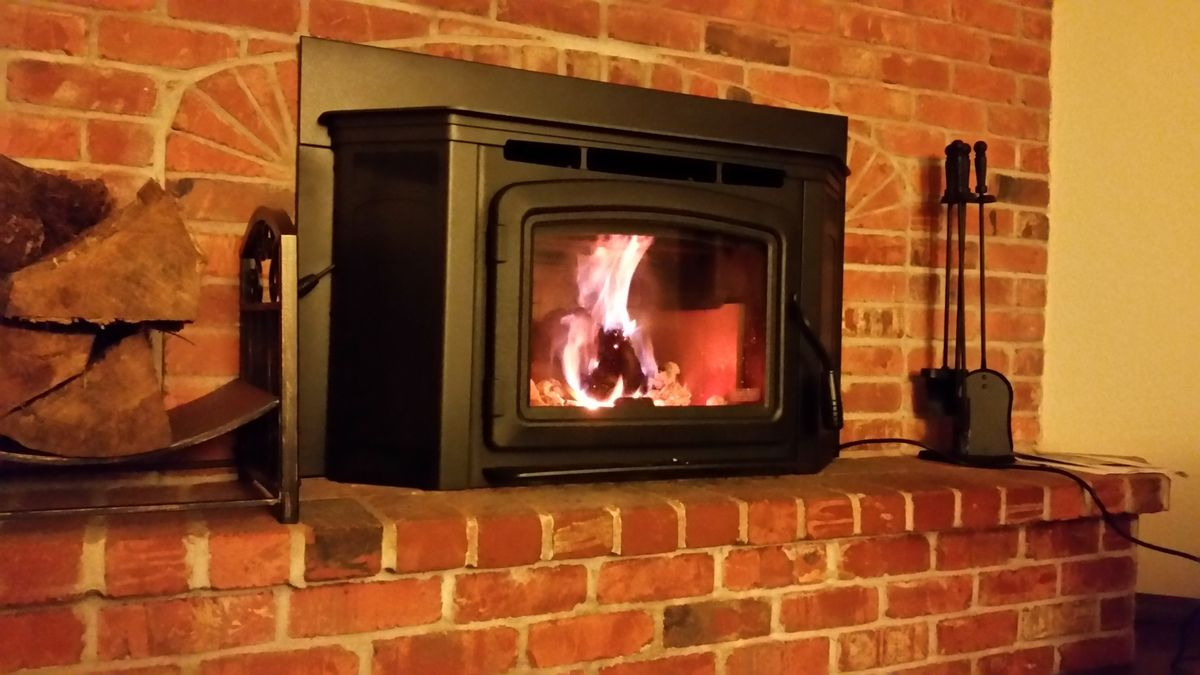 method for opening up brick fireplace to accomodate an insert
