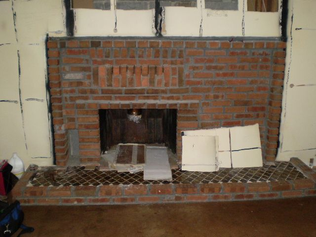 I am planning to re-do our fireplace interior brick facing to stone and am trying to decide which is better: Tearing out the brick and re-building with...