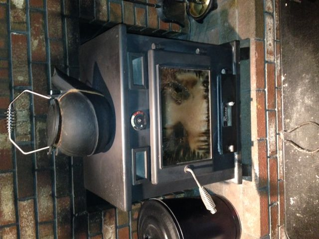 here are the pics I took....sorry for the delay....my brother got married  on sunday and i have finally recovered. - 1980 Russo C/Wood Stove, Owners Manual ? Hearth.com Forums Home