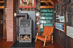 living-and-dining-area-with-fire-stove-and-vintage-furniture.jpg